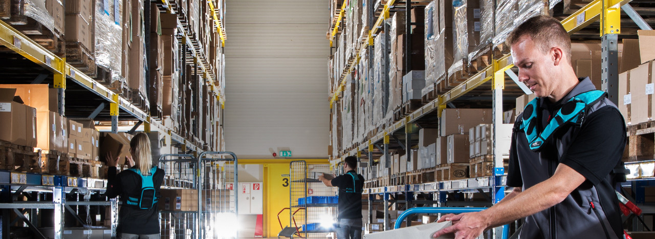 The three warehouse workers benefit from the Lydia Voice Integration