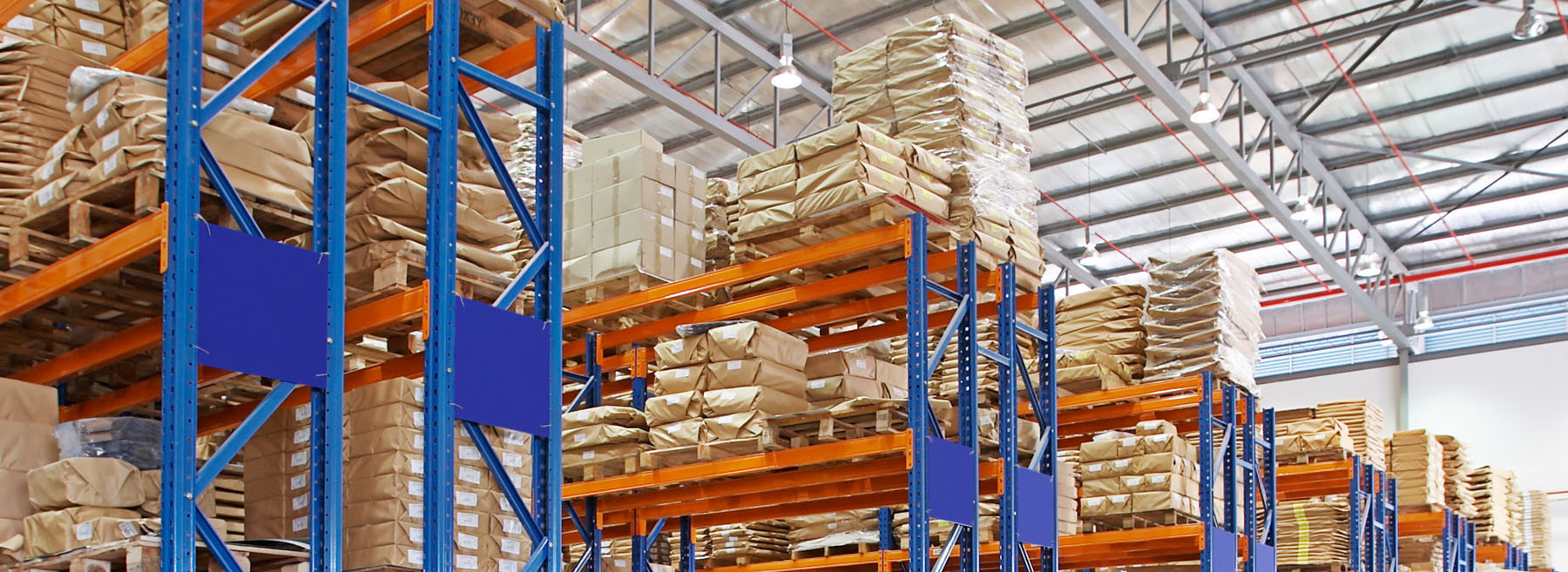 The picture shows a warehouse and shelfs.