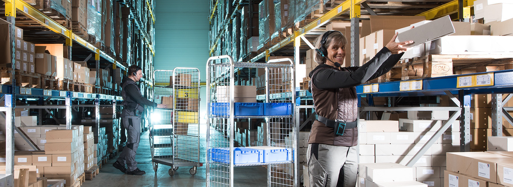 Two warehouse workers benefits of the voice picking system